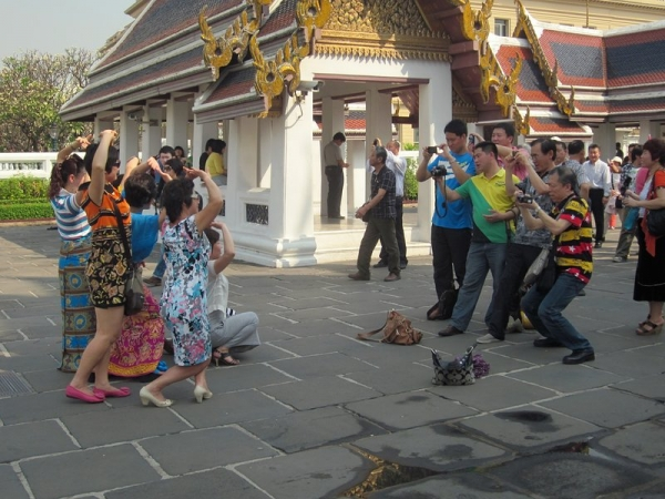 Asian tourists at the Grand Palace