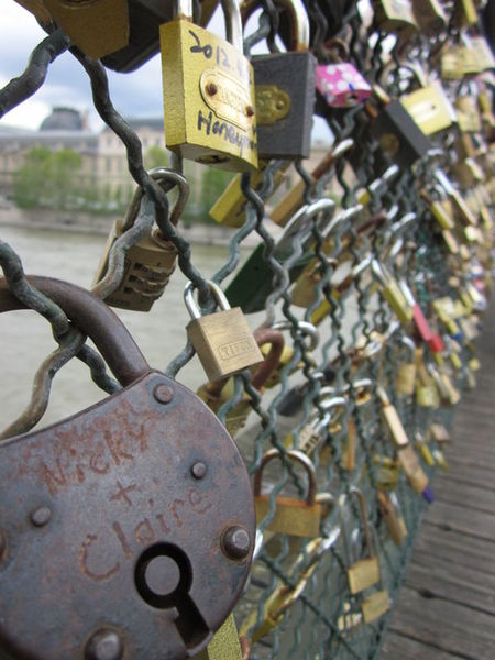 Thousands of locks locked to a Paris bridge by couples in love