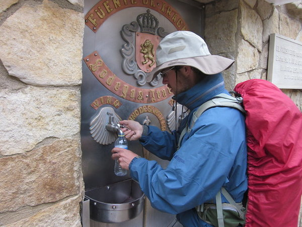 Attempting to fill up on red wine at the FREE WINE FOUNTAIN at Irache monastery... unfortunately, the taps were dry early this Sunday morning
