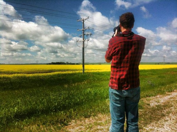 Mike taking a road side photo - The Hills of Saskatchewan